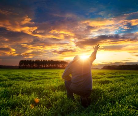 Man on knees thanking God